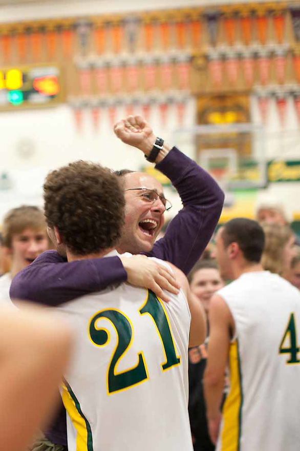A parent celebrates after San Marin's upset victory against Bishop O'Dowd High School.