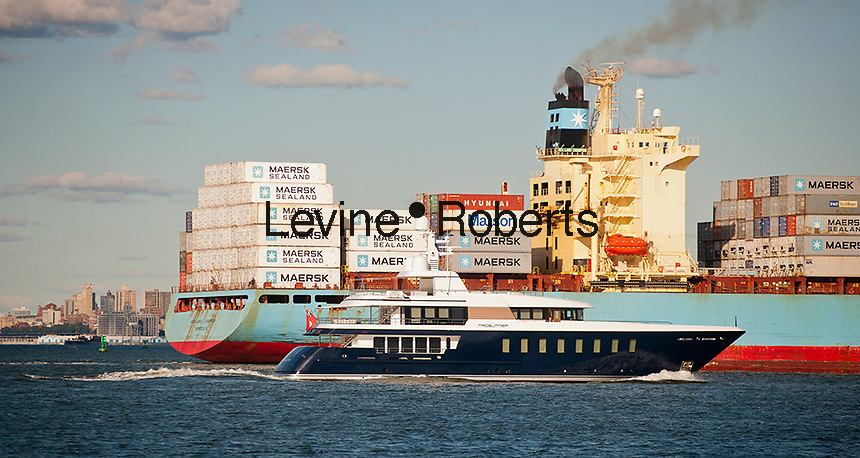 The Maersk line Sea Land Champion laden with containers leaves port in the New York and New Jersey harbor next to an ocean going yacht on Sunday, September 23, 2012.  (© Richard B. Levine)