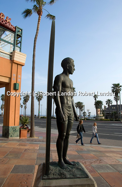 Statue of surfer across from pier in Huntington Beach, CA
