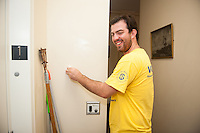 Aidan McCormack,'20, washes walls at the Seamen's Church Institute in Newport during Salve Regina's Exploration Day of Service.