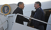 Chicago, IL - January 4, 2009 -- United States President-elect Barack Obama (L) greets a member of the flight crew as he boards his flight to Washington, DC USA at Midway Airport in Chicago, Illinois, USA 04 January 2009. Obama will join his wife and children who are already in Washington as he prepares to take the oath of office on 20 January. .Credit: Tannen Maury - Pool via CNP