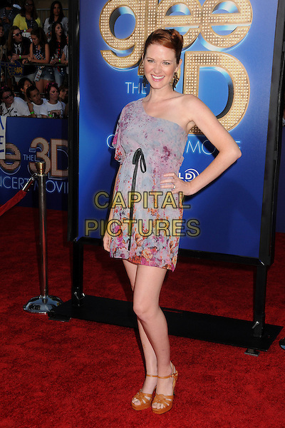 Sarah Drew.The 20th Century Fox 'Glee 3D' Concert World Movie Premiere held at The Regency Village theatre in Westwood, California, USA,.August 6th 2011..full length one shoulder blue dress pink print floral black bow hand on hip .CAP/ADM/BP.©Byron Purvis/AdMedia/Capital Pictures.