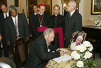 "HAVANA, CUBA: April 4, 2005.- Former Cuban President Fidel Castro signed the ""Book of Condolences"" at the headquarters of the Catholic Nunciature in Havana for the death of Pope John Paul II. The Cuban Cardinal Jaime Ortega, who with Pope Francisco helped the restoration of relations between Cuba and the United States. Ortega will leave the leadership of the Catholic Church on the island, said Vatican. . Credit: Jorge Rey/MediaPunch"