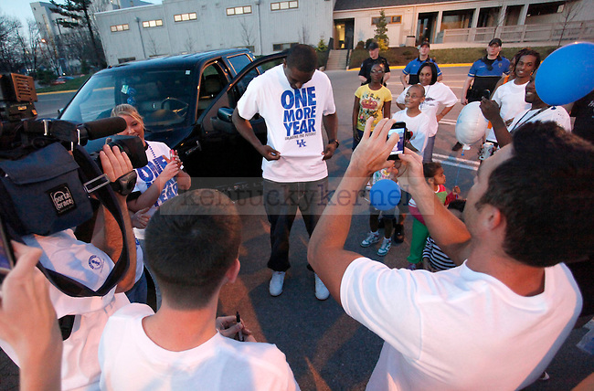 """Patrick Patterson displays a """"One More Year"""" shirt for fans during the Rally for One More Year held outside the WIldcat Lodge Thursday evening. Photo by Zach Brake 