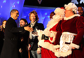 Washington, DC - December 3, 2009 -- United States President Barack Obama greets Santa and Mrs. Claus at the lighting of the National Christmas tree on the Ellipse in Washington, D.C. on Thursday, December 3, 2009.  Left to right: President Obama,  singer Sheryl Crow , Santa and Mrs. Claus  .Credit: Dennis Brack / Pool via CNP