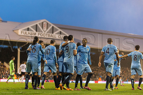 21.12.2013 London, England.  Manchester City's Vincent KOMPANY celebrates with teammates after scoring during the Premier League game between Fulham and Manchester City from Craven Cottage.