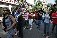 A Univision reporter conducting an interview boos at some United States fans marching to Azteca stadium from the Zona Rosa District of Mexico City. The United States Men's National Team played Mexico in a CONCACAF World Cup Qualifier match at Azteca Stadium in, Mexico City, Mexico on Wednesday, August 12, 2009.