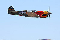 """John Curtiss Paul pilots the P-40N Warhawk """"Parrothead"""" during the Unlimited Bronze Class Finals at the 2009 National Championship Air Races. Race 17 was disqualified from the race by the Contest Committee for Low Flying."""