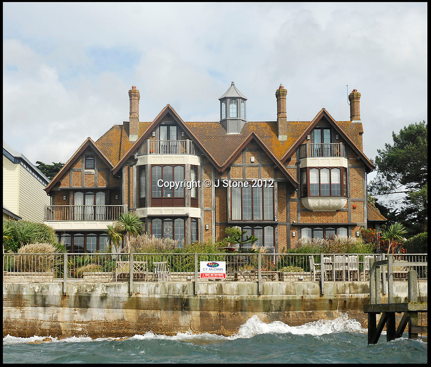 BNPS.co.uk (01202 558833)<br /> Pic: Lloyds/BNPS<br /> <br /> Harry Redknapp's Sandbanks home<br /> <br /> Humble origins of one of Britain's most exclusive addresses.<br /> <br /> A new book reveals how the millionaire's row of Sandbanks went from being a windswept wasteland to one of the most sought-after addresses in the world has been published. <br /> <br /> Today the harbour-front plots on the exclusive enclave in Poole, Dorset, are crammed with £10m mansions and luxury flats while Ferraris and Bentleys parade its tree-lined streets.<br /> <br /> But you only have to go back the relatively short period of 100 years to see that Sandbanks - or Parkstone-on-Sea as it was known - was once a deserted landscape cut off from the rest of the country.
