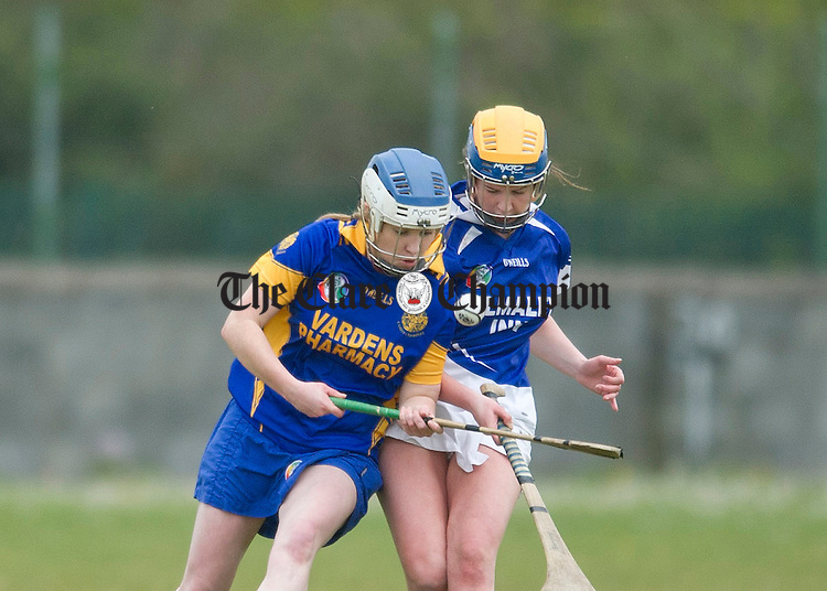 Áine O' Brien gathers posession under pressure from Newmarket's Niamh Cahill. Photograph by Declan Monaghan