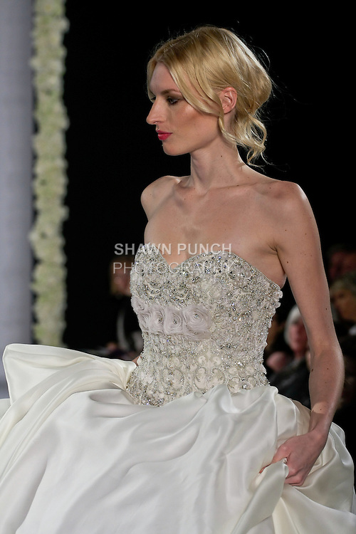 Model walks runway in an Adara bridal gown from the Katerina Bocci 2013 collection, at the Couture Runway Show, during New York Bridal Fashion Week at The Hilton Hotel, October 13, 2012.