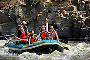 Bucking Rainbow Outfitters crashing Cable Rapid while floating the Upper Colorado River from Rancho Del Rio to Two Bridges on the morning of July 19, 2014.