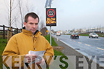 SLOW DOWN: John Cronin from Finuge with one of the self policing speed signs erected on the Killarney Road in Tralee.
