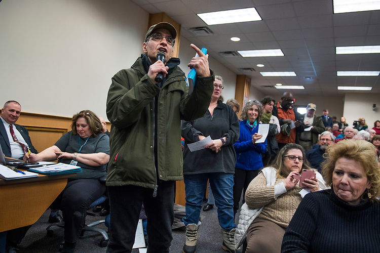 UNITED STATES - MARCH 16: A guest asks a question during a town hall meeting with Sen. Joe Manchin, D-W.Va., at the WVU Robert C. Byrd Health Sciences Center in Martinsburg, W.Va., March 16, 2017. Much of the discussion was regarding the American Health Care Act, the Republican's plan to repeal and replace the ACA. (Photo By Tom Williams/CQ Roll Call)