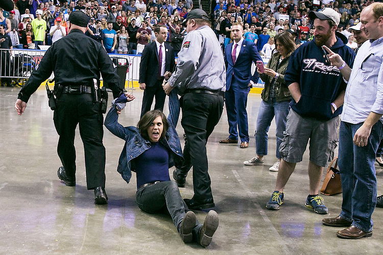 UNITED STATES - APRIL 18 - Protestors are removed by law enforcement and security as Republican presidential candidate Donald Trump speaks at a campaign rally at the First Niagara Center, in Buffalo, N.Y., Monday, April 19, 2016. Trump has focused his campaign on the New York Primary, which is Tuesday, April 19, 2016. (Photo By Al Drago/CQ Roll Call)