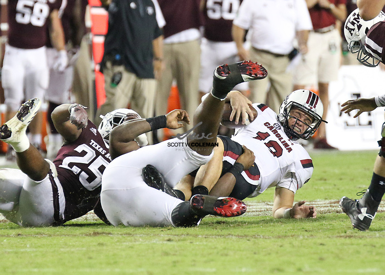 South Carolina Gamecocks quarterback Jake Bentley (19) is sacked by Texas A&M Aggies defensive lineman Zaycoven Henderson (92) during the fourth quarter of the NCAA football game between the Texas A&M Aggies and the South Carolina Gamecocks at Kyle Field in College Station, Texas. The Aggies won 24-17.