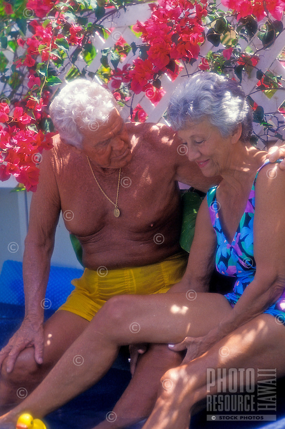 Senior couple enjoying themselves at the beach