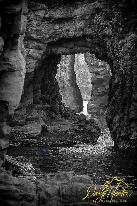 The sea stack arches of Futo Beach, Shizuoka, Japan. Black and White