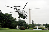 Washington, D.C. - May 26, 2009 -- United States President Barack Obama departs the White House aboard Marine 1 for a visit to Las Vegas, Nevada on Tuesday, May 26, 2009..Credit: Ron Sachs / Pool via CNP