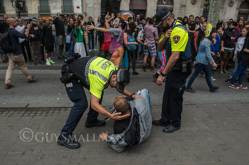 Students and activists protest, block roads and close open shops and business in support of the Catalan general strike. 3-10-17 Undercover police officer is rescued by uniformed colleagues after being recognised by activists.