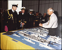 BNPS.co.uk (01202 558833)Pic: PhilipWarren/BNPS<br /> <br /> Prince Andew is presented with a match stick model of his ship, HMS Cumberlan, at Broughton Airfield in the late 1980s.<br /> <br /> Prince Andew is presented with a match stick model of his ship by Philip Warren.<br /> <br /> Master modeller Philip Warren has spent 70 years building an incredible fleet of 484 warships and he says he is not ready to sail into the sunset.<br /> <br /> Philip, 87, has dedicated his entire adult life to crafting the matchstick armada and has built every class of ship in the Royal Navy since 1945, using over a million matchsticks.<br /> <br /> He recently completed a magnificent 3ft replica of the HMS Queen Elizabeth aircraft carrier which took him eight months.