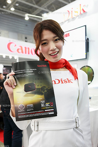 An exhibitor poses for a photograph at the CP+ 2016 Camera & Imaging Show on February 25, 2016, in Yokohama, Japan. CP+ is the biggest camera and photo imaging showcase in Japan with 132 exhibitors across  1,073 booths in Osanbashi Hall and Pacifico Yokohama, and organizers expect 70,000 visitors over the course of the exhibition that runs until Sunday 28th. (Photo by Rodrigo Reyes Marin/AFLO)