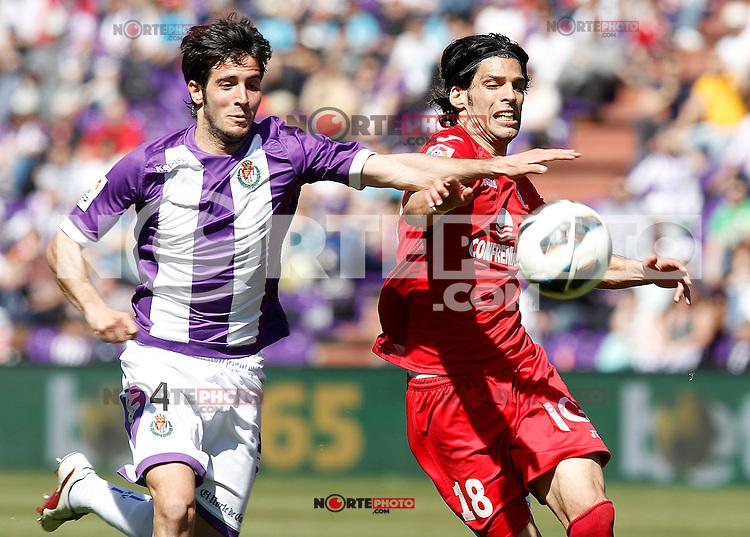 Real Valladolid's Marc Valiente (l) and Getafe's Angel Lafita during La Liga match.April 13,2013. (ALTERPHOTOS/Acero)