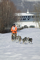 Musher Al Stead passes Creamers Field on day three of the oldest continuously run sled dog race in the world, the 2003 Open North American Sled dog championships, Fairbanks, Alaska. The annual race consists of three daily races, the combined fastest time wins.