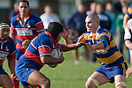 R. Avei looks to fend off R. Matherson. Counties Manukau  Premier Club Rugby Round 3 game between Patumahoe & Ardmore Marist played at Patumahoe on the 28th of April 2007. Patumahoe led 25 -12 at halftime and went on to win 32 - 15.