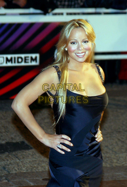 MARIAH CAREY.NRJ Music Awards in Cannes.Ref: J Kassner.hands on hips, blue miniskirt, train, black sandals, heels, cleavage, half length, half-length.www.capitalpictures.com.sales@capitalpictures.com.©Capital Pictures