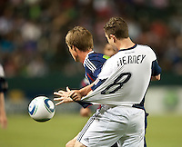 CARSON, CA – APRIL 30, 2011: Chivas USA forward Justin Braun (17) and New England Revolution defender Chris Tierney (8) battle for the ball during the match between Chivas USA and New England Revolution at the Home Depot Center, April 30, 2011 in Carson, California. Final score Chivas USA 3, New England Revolution 0.
