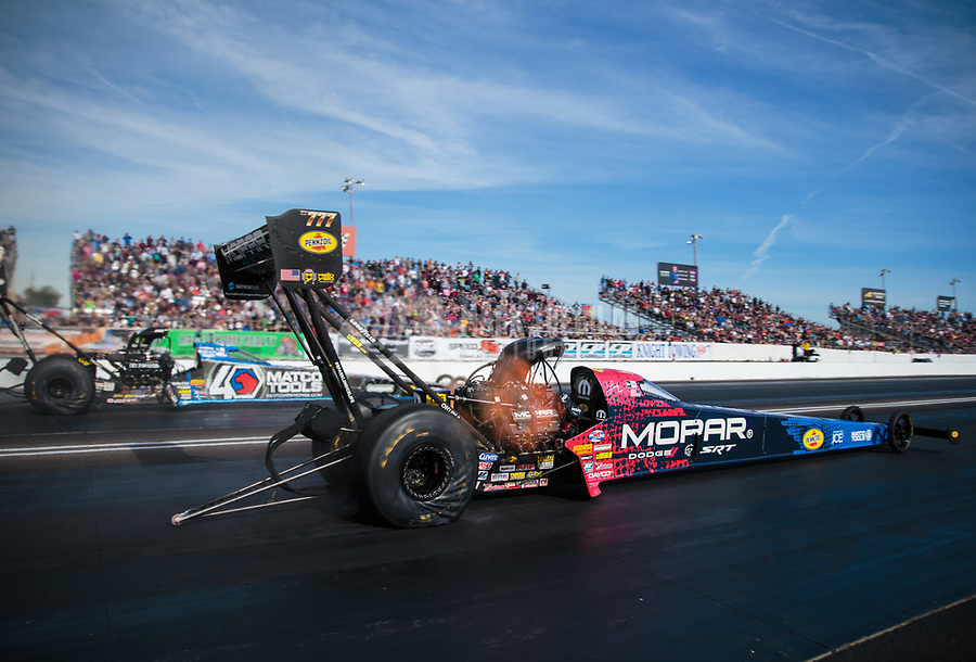 Feb 24, 2019; Chandler, AZ, USA; NHRA top fuel driver Leah Pritchett (near) defeats teammate Antron Brown during the Arizona Nationals at Wild Horse Pass Motorsports Park. Mandatory Credit: Mark J. Rebilas-USA TODAY Sports