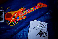 A toy guitar is seen next to flyers while protesters of the Occupy Wall Street movement celebrate their first anniversary with marches and confrontations with the New York police where 150 protesters have been arrested during weekend celebrations in Manhattan.  Photo by Eduardo Munoz Alvarez / VIEWpress.