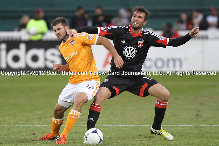 18 November 2012: Houston's Will Bruin (12) and DC's Emiliano Dudar (ARG) (right). DC United tied the Houston Dynamo 1-1 at RFK Stadium in Washington, DC in the second leg of their 2012 MLS Cup Playoffs Eastern Conference Final series. Houston advanced to MLS Cup 2012 on aggregate goals, 4-2.