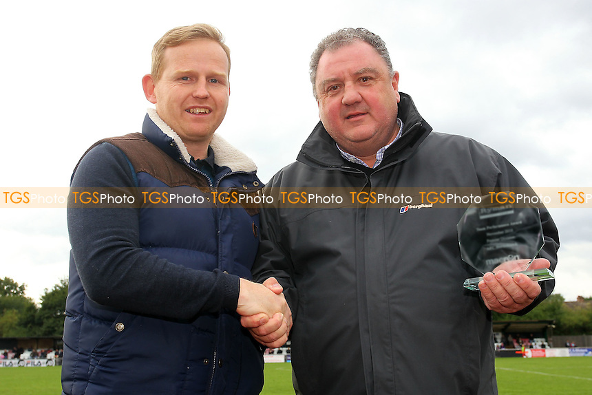 AFC Hornchurch Chairman Colin McBride makes a presentation to Andy Tomlinson ahead of the match - AFC Hornchurch vs Wealdstone - FA Challenge Cup 3rd Qualifying Round Football at The Stadium, Bridge Avenue - 12/10/13 - MANDATORY CREDIT: Gavin Ellis/TGSPHOTO - Self billing applies where appropriate - 0845 094 6026 - contact@tgsphoto.co.uk - NO UNPAID USE