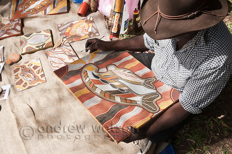 Indigenous man painting traditional artwork.  Cooktown, Queensland, Australia