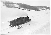 Tender-end, engineer's-side view of RGS K-27 #455 traveling light in fresh snow.<br /> RGS  Noel, CO  Taken by Reid, Homer