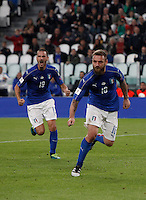 Italy Daniele De Rossi, right, celebrates past teammate Leonardo Bonucci after scoring the equalizer goal on a penalty kick during the Fifa World Cup 2018 qualification soccer match between Italy and Spain at Turin's Juventus Stadium, October 6, 2016. The game ended 1-1.<br /> UPDATE IMAGES PRESS/Isabella Bonotto