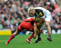 London, England. Joe Marler of Harlequins tackled during the Saracens and Harlequins Aviva Premiership with a world record crowd of 83,761 for a club rugby match at Wembley Stadium. 31March 2012 at Wembley Stadium, London, England,