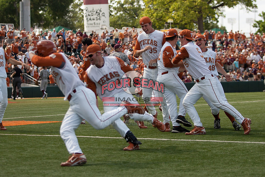 The Texas Longhorn baseball team celebrates their walk-off win against the Texas A&M Aggies on April 29, 2012 at UFCU Disch-Falk Field in Austin, Texas. The Longhorns beat the Aggies 2-1 in the last ever regular season game scheduled for the long time rivals. (Andrew Woolley / Four Seam Images)