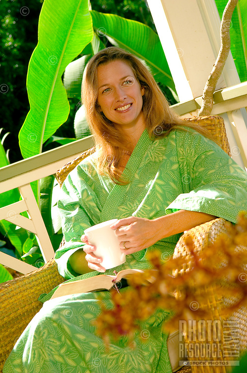 Woman Enjoys Morning Coffee On Lanai of Her Home