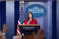 White House Press Secretary Sarah Huckabee Sanders answers questions from the media during the White House daily press briefing at the White House in Washington, DC on May 3, 2018. Credit: Alex Edelman / CNP /MediaPunch