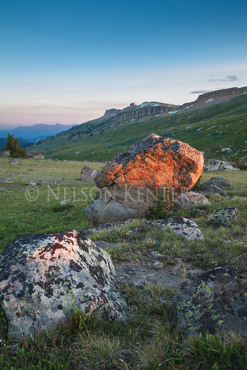 setting sun lights rocks along the high lakes trail in the absaroka beartooth wilderness area