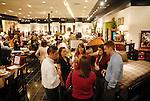 Guests mingle during a grand opening party at the new Gallery Furniture location at 2411 Post Oak  Wednesday March 11, 2009. (Dave Rossman/For the Chronicle)