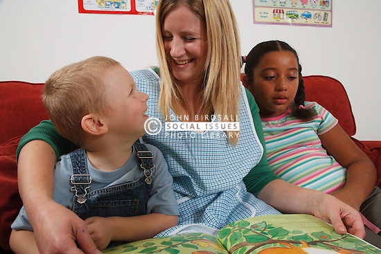 Nursery nurse with children