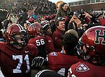 (Cambridge Ma 11/22/14) Players and fans celebrate the win as Harvard defeated Yale 31-24. Jim Michaud Photo