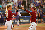 OKLAHOMA CITY, OK - JUNE 04: Meghan King #48 and Cali Harrod #10 of the Florida State Seminoles share a moment against the Washington Huskies during the Division I Women's Softball Championship held at USA Softball Hall of Fame Stadium - OGE Energy Field on June 4, 2018 in Oklahoma City, Oklahoma. (Photo by Shane Bevel/NCAA Photos via Getty Images)