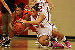 SIOUX FALLS, SD - JANUARY 22:  Sydney Arrington #50 from Washington battles for the loose ball with Cera Ledbetter #54 from Lincoln in the first quarter of their game Tuesday night at Lincoln. (Photo by Dave Eggen/Inertia)