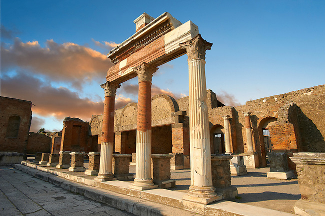 The Roman Corinthian Porticus, columns & tables of the money changers at the entrance of the Macellum in the Forum of Pompeii archaeological site, Italy.
