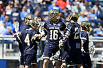 DURHAM, NC - APRIL 08: Notre Dame's Sergio Perkovic (16) celebrates his 100th goal with Anthony Marini (4) and Bryan Costabile (26). The Duke University Blue Devils hosted the University of Notre Dame Fighting Irish on April 8, 2017, at Koskinen Stadium in Durham, NC in a Division I College Men's Lacrosse match. Duke won the game 11-8.